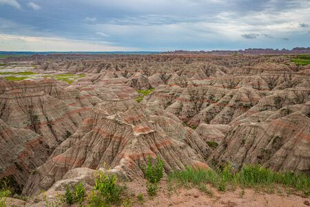 Badlands National Park is located in southwestern South Dakota, featuring nearly 400 square miles of sharply eroded buttes and pinnacles, and the largest undisturbed mixed grass prairie in the United States. Stock Photo
