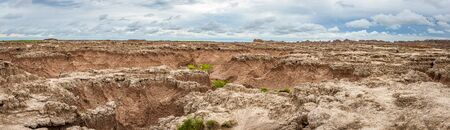 Badlands National Park is located in southwestern South Dakota, featuring nearly 400 square miles of sharply eroded buttes and pinnacles, and the largest undisturbed mixed grass prairie in the United States.