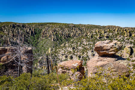 Chiricahua National Monument features nearly 12,000 acres of Rhyolite pinnacles, some rising hundreds of feet in the air, and is known as the