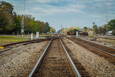 Jesup, GA - March 17, 2018: Double train tracks carry freight and passenger trains through the center of a small town in south Georgia. Фото со стока