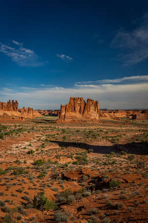 Sandstone rock formations including arches, natural bridges, windows, and pinnacles dominate the landscape at Arches National Park near Moab, Utah.