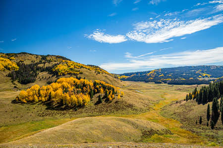 Beautiful mountain scenery with streams, valleys, and color changing trees along a train route from Chama, New Mexico to Antonito, Colorado