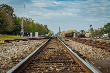 Jesup, GA - March 17, 2018: Double train tracks carry freight and passenger trains through the center of a small town in south Georgia.