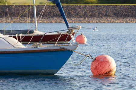 Small sailing yachts on a mooring ball