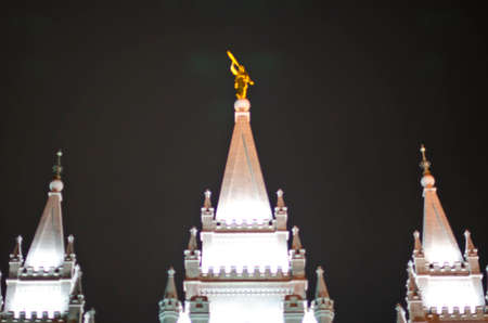 A wide view of the golden moroni on the top of the salt lake city temple.