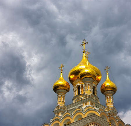 Orthodox church with golden domes photo