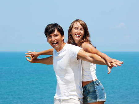Happy Young Couple Embracing on a Beach Stock Photo