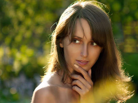 Beautiful Woman Posing on Summer Nature Background