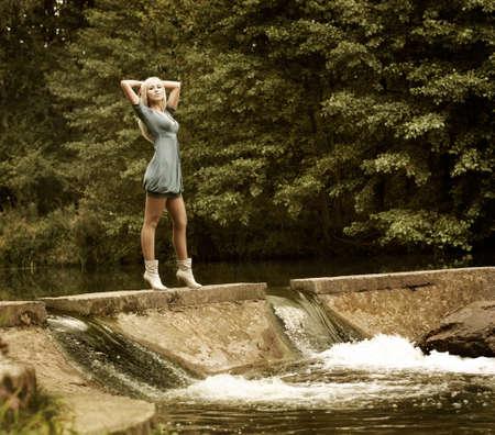 Fashion Photo of Blonde Woman Posing on Nature Background