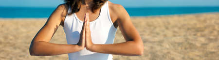 Woman Practicing Yoga Meditation near the Sea Stock Photo - 15056437