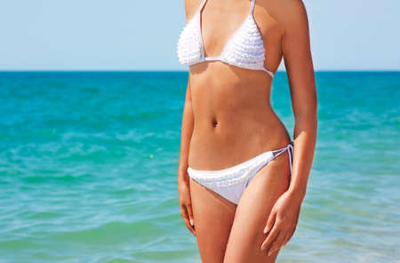 Beautiful Woman in Bikini Standing at Sea Stock Photo - 15056443