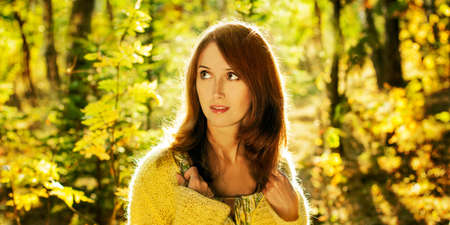 Brunette Woman Walking in Sunny Autumn Forest  High-res Panorama  Stock Photo