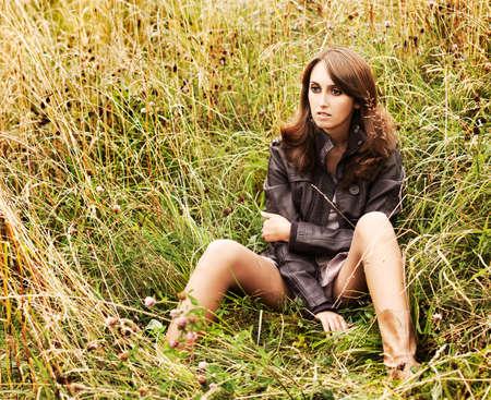 Beautiful Fashion Girl Sitting on Nature Background Stock Photo - 15869178