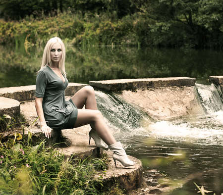 Fashion Photo of Blonde Woman Posing on Nature Background Stock Photo - 15918999