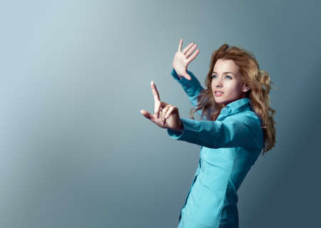 Portrait of a Woman Pressing an Imaginary Button  Focus on Hand  Copy space  photo