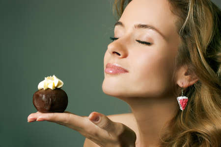 Beautiful Woman with a Cake  Guilty Pleasure Concept  Copy Space  Stock Photo