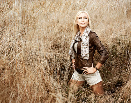 Sexy Blonde Woman Standing at the Field Stock Photo - 16030185