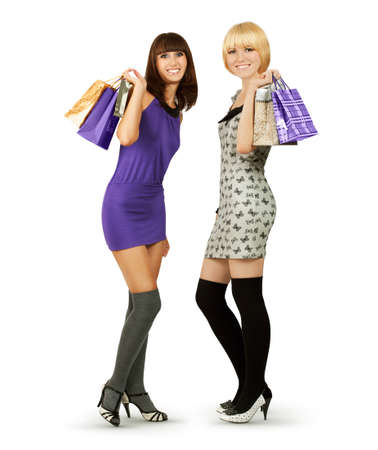 Two Young Women with Shopping Bags Isolated on White photo