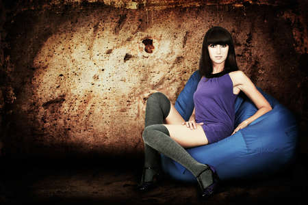 Sensual Brunette Woman in Purple Dress against Concrete Wall Stock Photo - 16547634