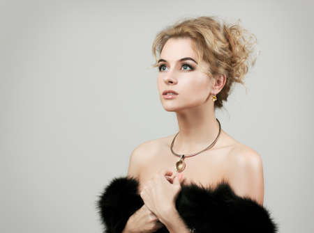 Portrait of Stylish Woman in Fur against Grey Background Stock Photo - 17049468