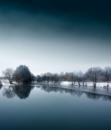 Winter Landscape with Calm River and Trees over Water  Copy space  Stock Photo