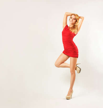 Full Length Portrait of a Sexy Blonde Woman in Red Fashion Dress Stock Photo