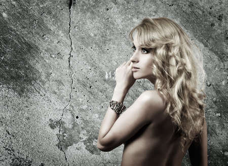 Portrait of Blonde Woman against Gray Wall Background Stock Photo - 18766220