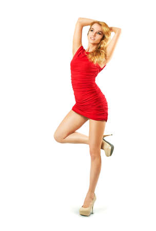 Full Length Portrait of a Sexy Blonde Woman in Red Fashion Dress Isolated on White
