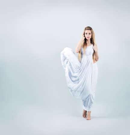 Aphrodite Styled Woman in Waving White Dress  Ancient Greek Goddess  Stock Photo