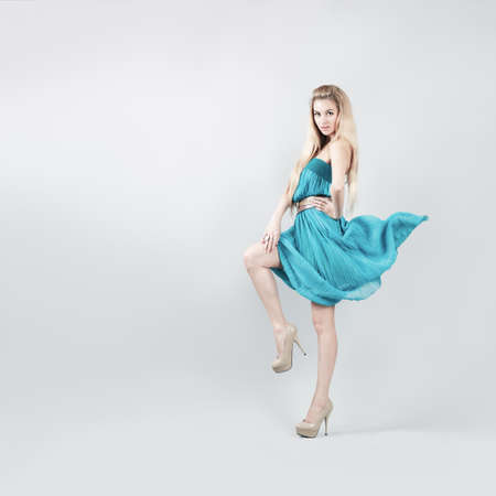 Full Length Portrait of a Sexy Blonde Woman in Turquoise Fashion Dress Stock Photo - 19575807