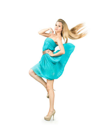 Full Length Portrait of a Sexy Blonde Woman in Turquoise Fashion Dress Isolated on White photo