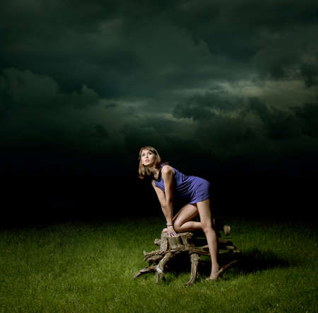 seductive women: Fashion Woman Standing with the Old Stump at Night