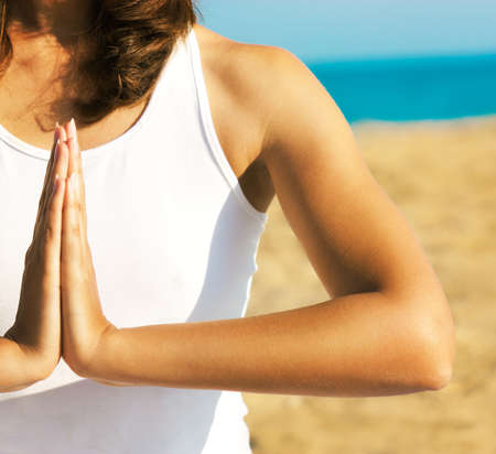 Woman Practicing Yoga Meditation near the Sea  Close Up  photo