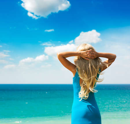 Blonde Woman in Turquoise Dress Standing at Sea  Summer Vacation