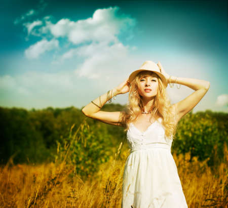 Portrait of Blonde Woman at Summer Field