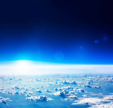 Earth View from Space  Dark Blue Sky with Rised Sun and Clouds