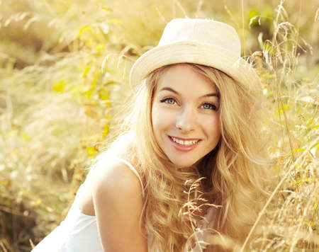 Portrait of Happy Blonde Woman At Summer Meadow