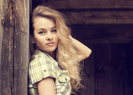 Toned Portrait of Beautiful Blonde Woman on Wooden Background Stock Photo