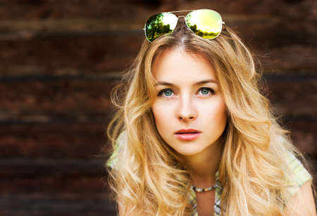 brown haired: Portrait of Beautiful Blonde Woman on Wooden Wall Background