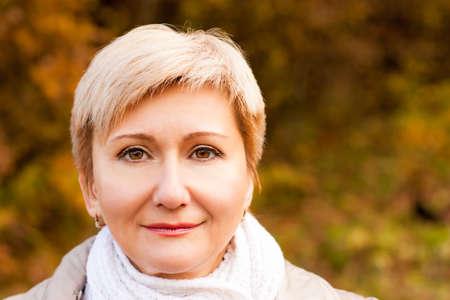 Portrait of Smiling Senior Woman on Autumn  Banco de Imagens