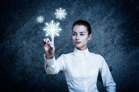 Beautiful Woman Pointing at Glowing Snow Icon photo