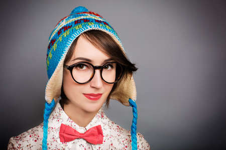 Studio Portrait of Trendy Hipster Girl in Funny Winter Hat photo