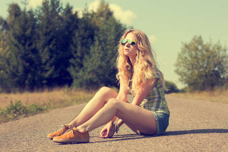 Trendy Hipster Girl Sitting on the Road  Toned Photo  Modern Youth Lifestyle Concept