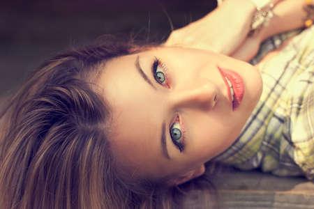 Close-up Portrait of Lying Beautiful Woman Stock Photo