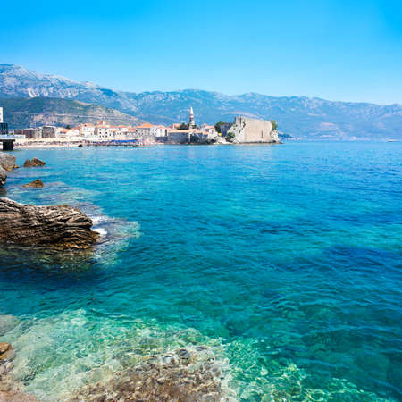 View of Budva Old Town with Clear Blue Water in Foreground  Montenegro, Balkans, Adriatic Sea  European Summer Resort in Mediterranean  Copy Space  photo
