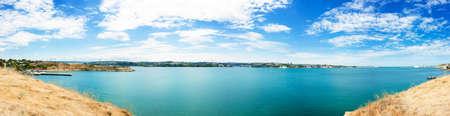 Panoramic View of Sevastopol, Crimea, Ukraine. Beautiful Cityscape with Blue Sky, Clouds and Azure Sea.