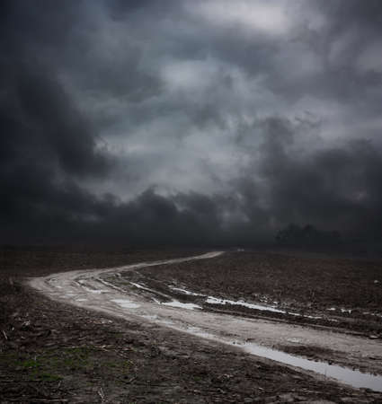 Dark Landscape with Dirty Road and Moody Sky. HDR Cloudscape. photo
