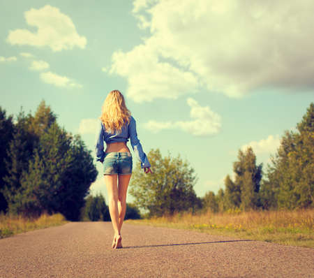 Full Length Photo of Sexy Blonde Woman Walking Away  Toned Photo  Trendy Street Style  photo