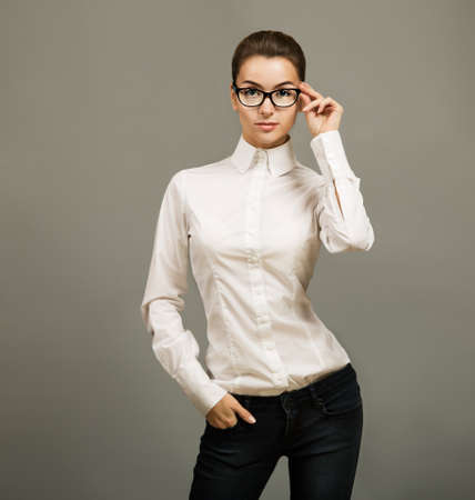 Portrait of Beautiful Business Woman Standing in White Shirt and Glasses