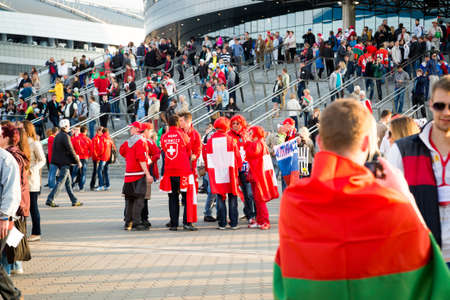 MINSK, BELARUS - MAY 9 - Belarussian, Swiss and Russian Fans with Flags in Front of Minsk Arena on May 9, 2014 in Belarus  Ice Hockey World Championship  IIHF  Opening